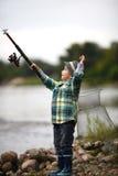 Фото рыболовства мальчика Стоковое фото RF