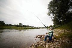 Фото рыболовства мальчика Стоковое Изображение RF