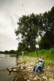 Фото рыболовства мальчика Стоковые Фотографии RF