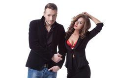 Фото сексуальных пар представляя в вскользь одеждах Стоковое фото RF