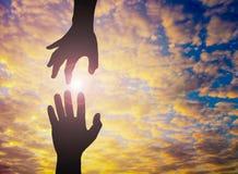 Фото силуэта руки к руке Стоковая Фотография RF