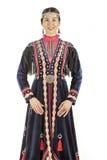 Фото студии девушки восточной печатает внутри Bashkir национальный костюм, нацию живя на территории России Стоковое фото RF