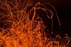 Фото sparkles огня Стоковые Фотографии RF