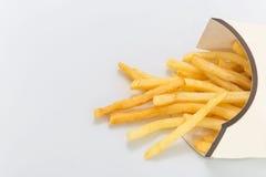 Фраи француза на белой предпосылке Быстро-приготовленное питание Стоковые Фото