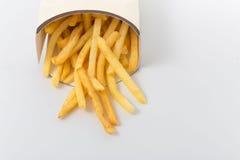 Фраи француза на белой предпосылке Быстро-приготовленное питание Стоковое фото RF