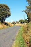 Французская дорога с деревьями и землей травы Стоковое Изображение
