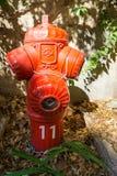 Французский красный жидкостный огнетушитель внутри Стоковые Фото