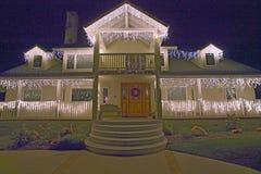 Фронт дома украшенный с светами праздника Стоковые Фотографии RF