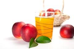 Фруктовый сок персика в стекле изолированном на белизне Стоковые Изображения