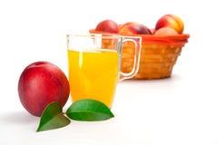 Фруктовый сок персика в стекле изолированном на белой предпосылке Стоковая Фотография