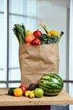Фрукты и овощи на таблице Стоковая Фотография