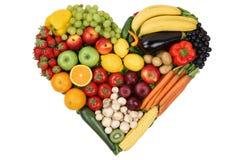 Фрукты и овощи формируя сердце любят тему и здоровое eatin Стоковое Изображение