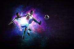Футболисты в действии Мультимедиа стоковые изображения