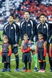 Футболисты Marquinhos, Buffon и Сильва PSG da на футбольном поле стоковые изображения rf