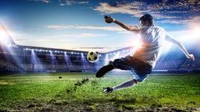 Футболист на стадионе Мультимедиа стоковое фото