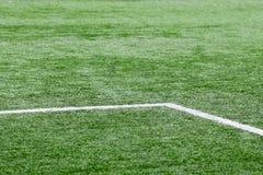 Футбольное поле с белыми маркировками Стоковые Фото