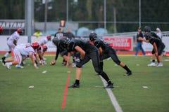Футбольный матч средней школы Стоковые Фотографии RF