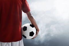 Футбольный мяч владением футболиста стоковая фотография rf