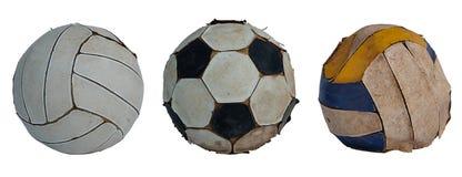 Футбол и волейбол собрания старые на белой предпосылке стоковые фотографии rf