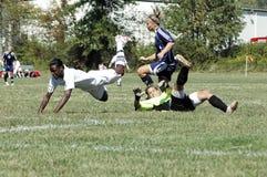 футбол коллежа женский младший Стоковая Фотография