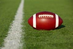 Футбол около линии разметки поля Стоковые Изображения RF