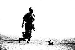 футбол силуэта игроков Стоковое Изображение