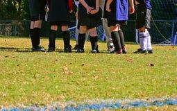 футбол huddle Стоковое фото RF