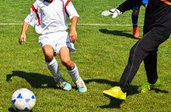 футбол игрока спички травы Стоковое Фото