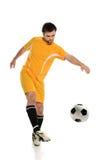 футбол игрока шарика пиная Стоковое фото RF