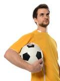 Футболист держа шарик стоковые изображения