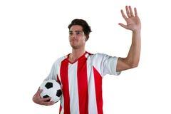Футболист развевая его рука стоковые фотографии rf