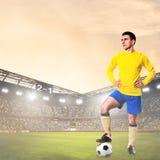 Футбол или футболист на стадионе стоковое изображение