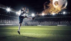 Футбол препровождает игрока Стоковое фото RF