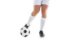 футбол шарика пиная игрока Стоковое Изображение