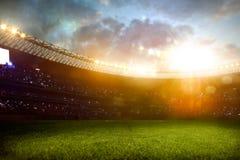 Футбольное поле арены стадиона вечера Стоковые Изображения