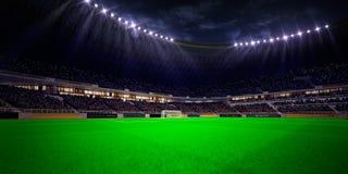 Футбольное поле арены стадиона ночи Стоковые Фотографии RF