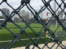 Футбольное поле за сетью Стоковые Фото