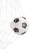 Футбольный мяч в сети цели Стоковая Фотография