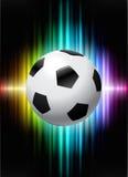 Футбольный мяч на абстрактной предпосылке спектра Стоковые Изображения
