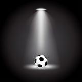 Футбольный мяч под иллюстрацией вектора светов Стоковое Изображение RF