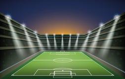 Футбольный стадион с светами пятна Стоковое Фото