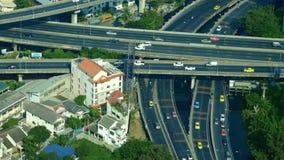Футуристическая панорама вида с воздуха городского пейзажа при автомобили двигая дальше шоссе bangkok Таиланд сток-видео