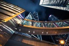 Футуристический городской пейзаж на ноче с небоскребами Стоковое Изображение