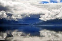 Фьорд и облака Стоковые Изображения