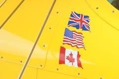 Флаги на желтом цвете Стоковое фото RF