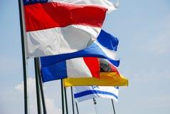 Флаги обматывают на верхней части Стоковое Фото