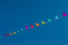 Флаги против голубого неба Стоковое Фото