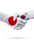 Флаги Япония, страны Южной Кореи, концепция рукопожатия приятельства партнерства иллюстрация вектора