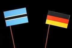 Флаг Ботсваны при немецкий флаг изолированный на черноте Стоковая Фотография RF
