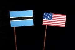 Флаг Ботсваны при флаг США изолированный на черноте Стоковое Изображение